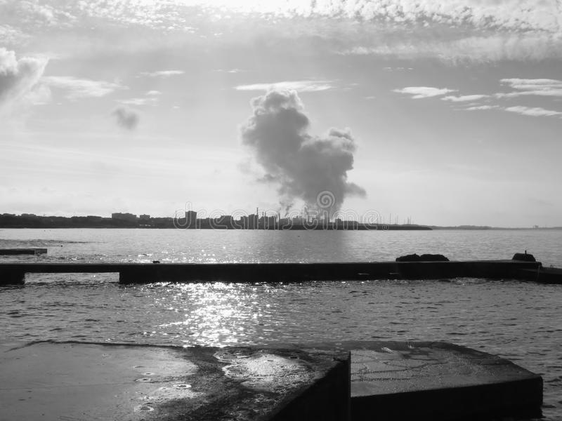 Download Industrial Landscape Along The Coast Air Polluting Factory Chimneys Black And White Photo