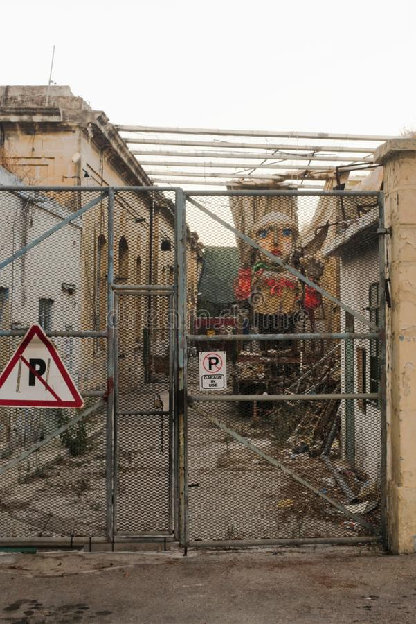 Floriana, Malta, August 2019. The old covered courtyard of the production room with the remains of carnival figures. royalty free stock photos