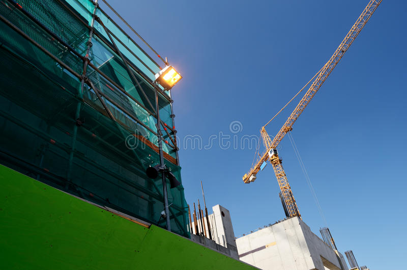 Industrial landscape, construction, crane. Against the blue sky royalty free stock photography