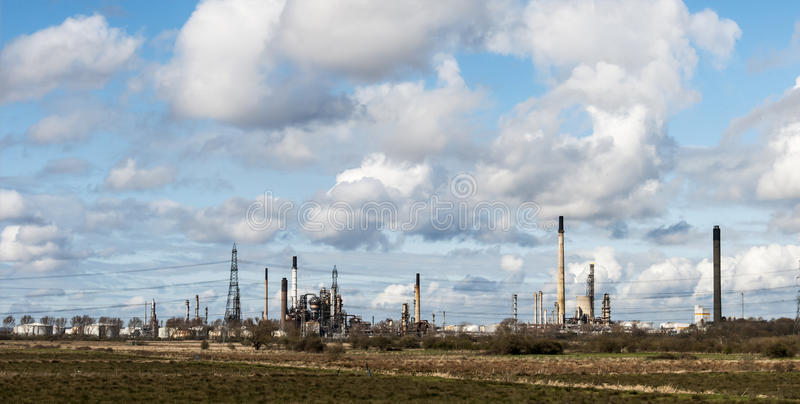 Industrial Landscape - At the Edge of The Greenbelt. View over industrial site at Ellesmere Port, United Kingdom royalty free stock images