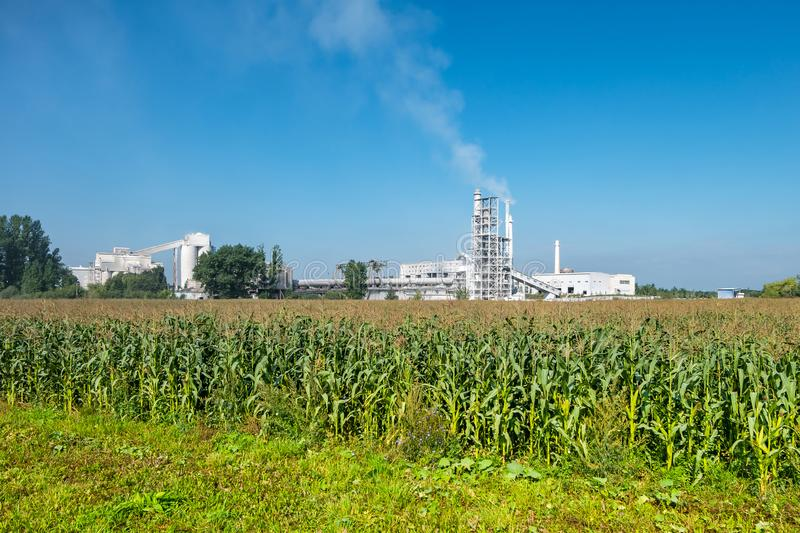 Industrial landscape environmental pollution waste of cement factory. Big pipes of industry enterprise plant. lime and chalk stock image