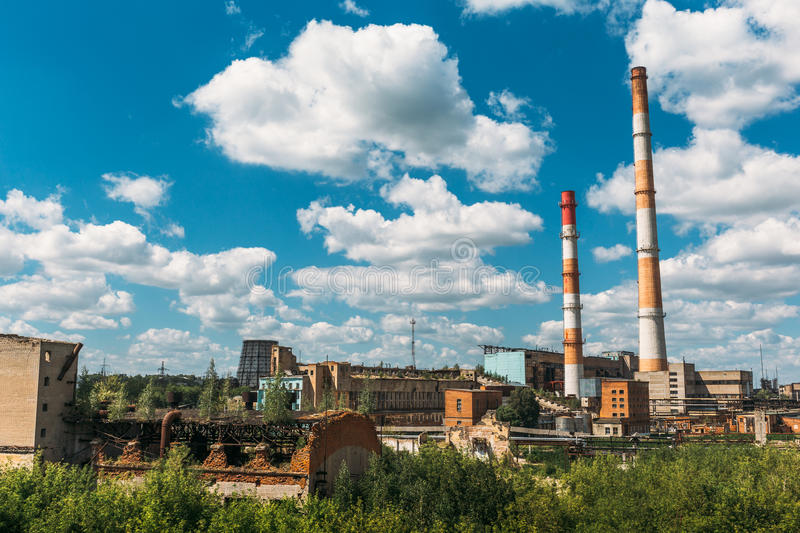 Industrial landscape. Metallurgical plant or factory. Pipes, factory buildings, steelworks, iron works. Heavy industry, bright blue sky for copy space royalty free stock photos