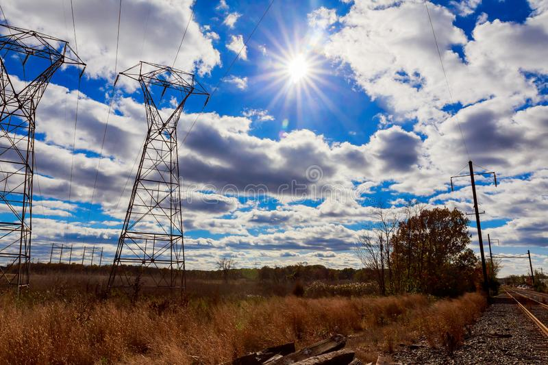 Industrial landscape - old abandoned  zone in autumn forest. Industrial landscape - old abandoned industrial zone in autumn forest autumn sky clouds power line stock photography