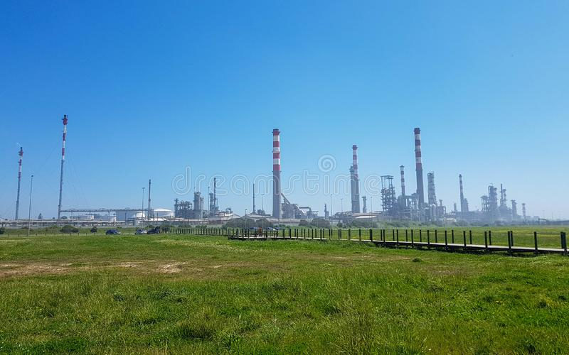 Industrial landscape with plant factory chimneys and beautiful spring nature landscape, Portugal royalty free stock photos