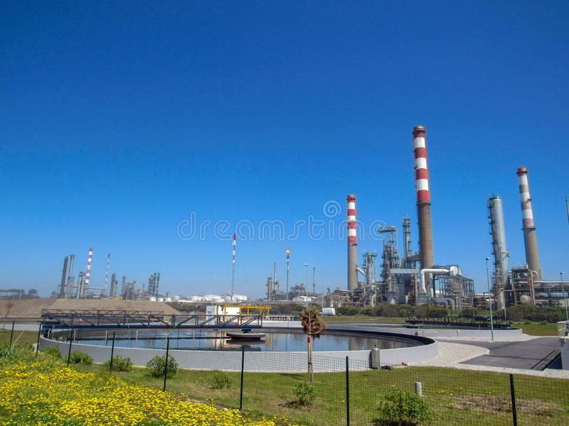 Industrial landscape with plant factory chimneys and beautiful spring nature landscape, Portugal, Europe royalty free stock image