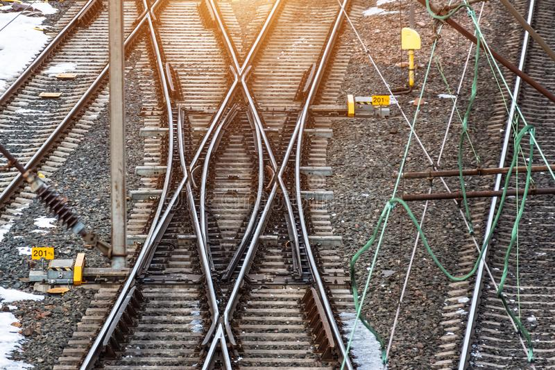 Industrial landscape with railroad tracks on concrete railway sleepers, arrows royalty free stock photos