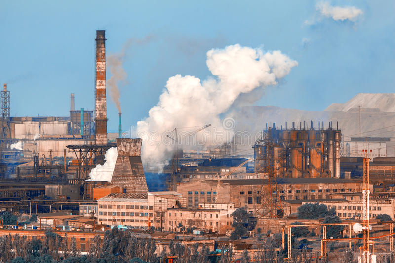 Industrial landscape. Steel factory. Heavy industry in Europe. Metallurgical plant. Industrial landscape. Steel factory at sunset. Pipes with smoke. steelworks stock images
