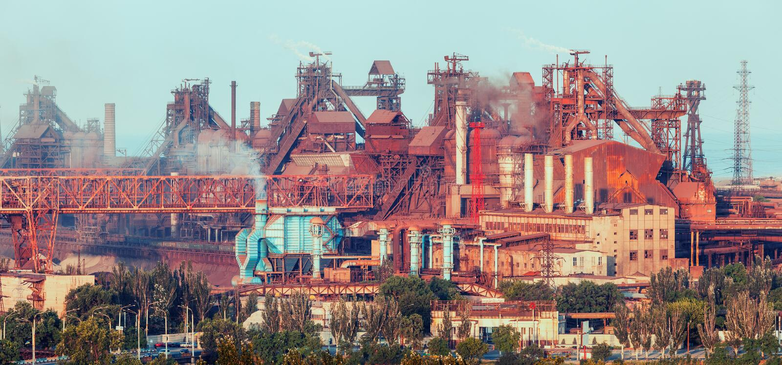 Industrial landscape. Steel factory. Heavy industry in Europe. Metallurgical plant. Industrial landscape. Steel factory at sunset. Pipes with smoke. steelworks royalty free stock photos
