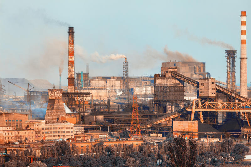 Industrial landscape. Steel factory. Heavy industry in Europe. Metallurgical plant. Industrial landscape. Steel factory at sunset. Pipes with smoke. steelworks stock photo