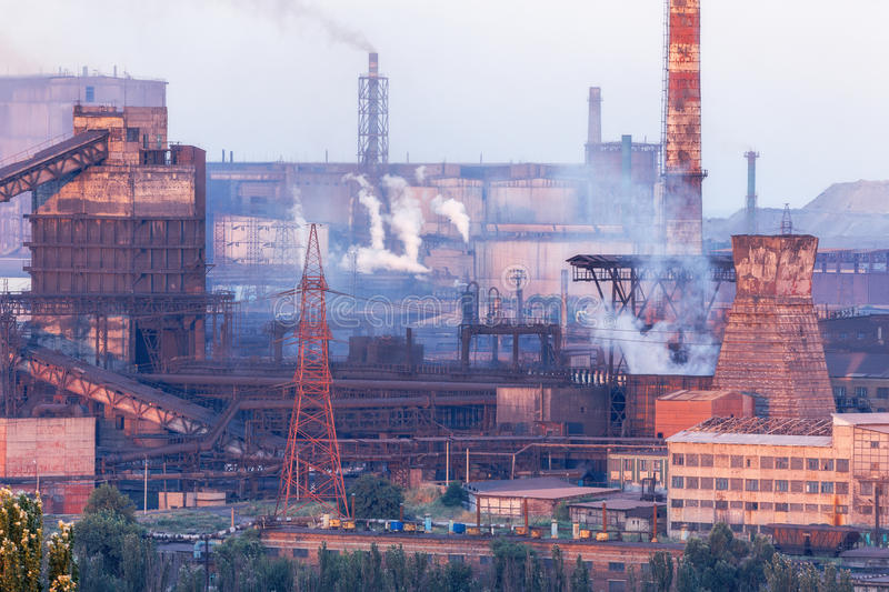 Industrial landscape in Ukraine. Steel factory at sunset. Pipes with smoke. Metallurgical plant. steelworks, iron works. Heavy ind. Ustry in Europe. Air stock photography