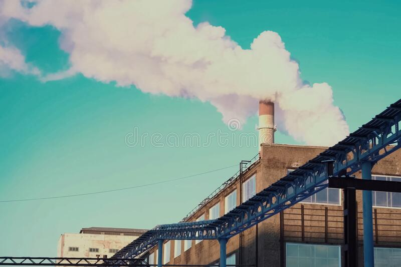 Industrial landscape, view of factory and boiler room. Smoke fro. Industrial landscape, view of the factory and boiler room. Smoke from the chimney stock photography