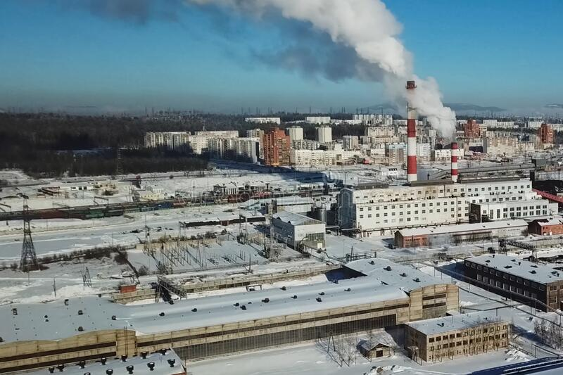 Industrial landscape, view of factory and boiler room. Smoke fro. Industrial landscape, view of the factory and boiler room. Smoke from the chimney royalty free stock photo