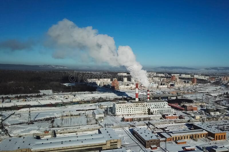Industrial landscape, view of factory and boiler room. Smoke fro. Industrial landscape, view of the factory and boiler room. Smoke from the chimney royalty free stock image