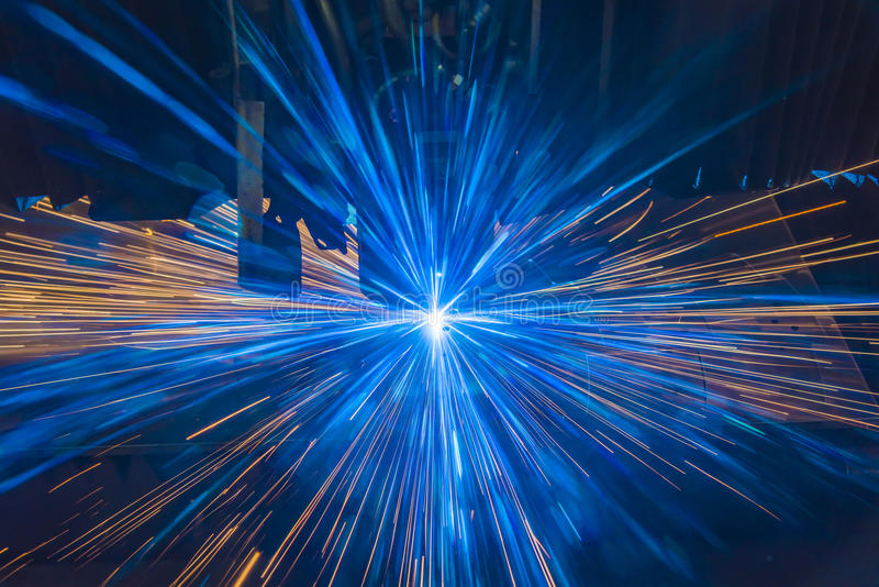 Industrial Laser cutting processing manufacture technology of flat sheet metal steel material with sparks royalty free stock images