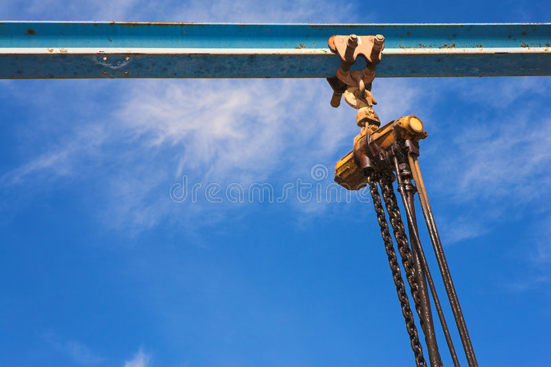 Industrial lifting winch and chain stock photography