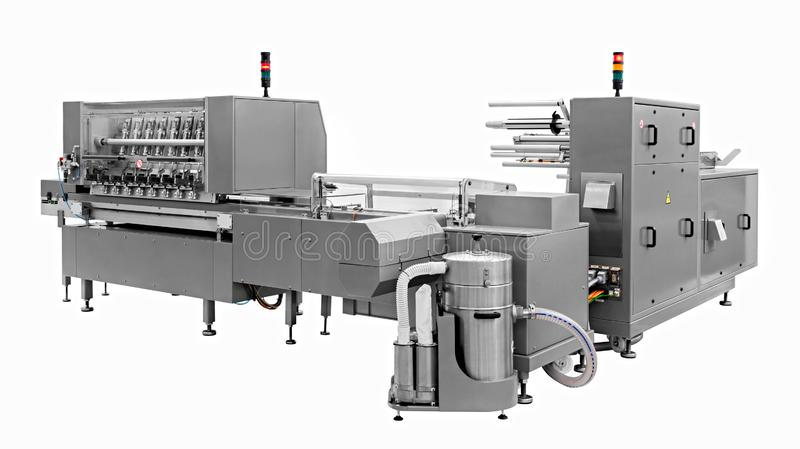 Industrial line for packaging of bakery products. Packing of bread at the factory. The machine for cutting and packing in a factory for the production of bread royalty free stock image