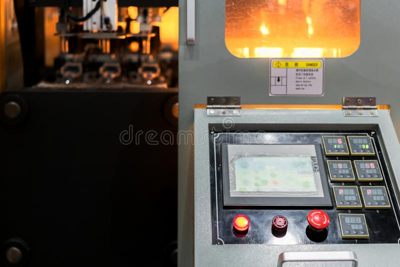 Industrial Machine control by programing logical control Automatic PET/ Plastic bottle blow moulding machine working in factory. Smart factory with 4.0 royalty free stock image