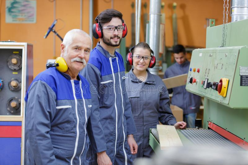 Industrial machine workers and operator royalty free stock photo