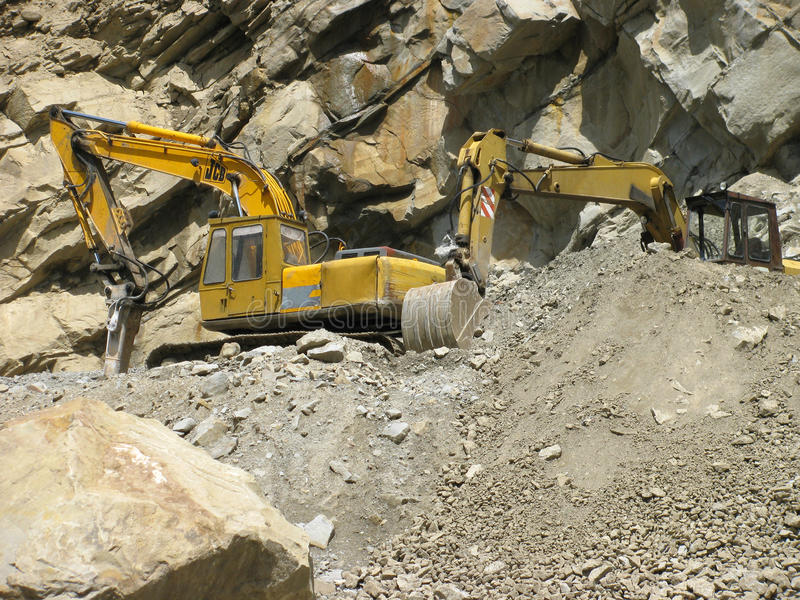 Industrial machines digging in the mountain royalty free stock photo