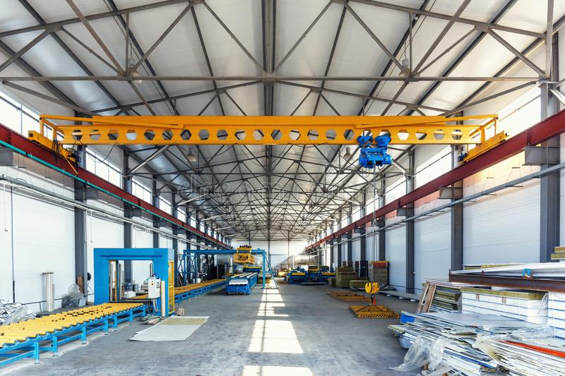 Industrial manufactory workshop for production sandwich panels for construction. Modern manufacturing storage factory interior royalty free stock images