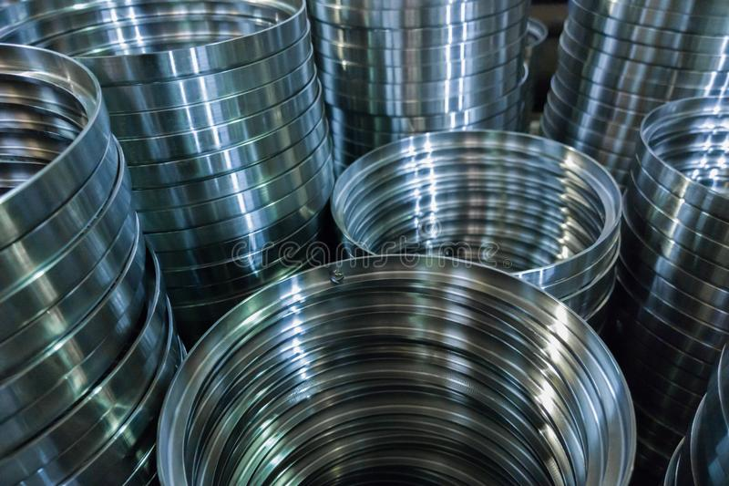 Industrial manufacturing background of columns of shiny metal rings after cnc turning operation royalty free stock photo