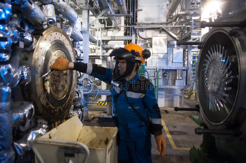 Industrial mechanic cleaning extruder machine. Tobolsk, Russia - July 15. 2016: Sibur company. Central control panel of Tobolsk Polymer plant. Industrial stock photos