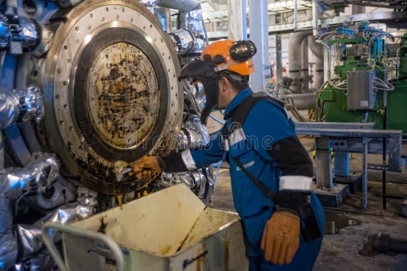 Industrial mechanic cleaning extruder machine. Tobolsk, Russia - July 15. 2016: Sibur company. Tobolsk Polymer plant. Industrial mechanic cleaning extruder stock images