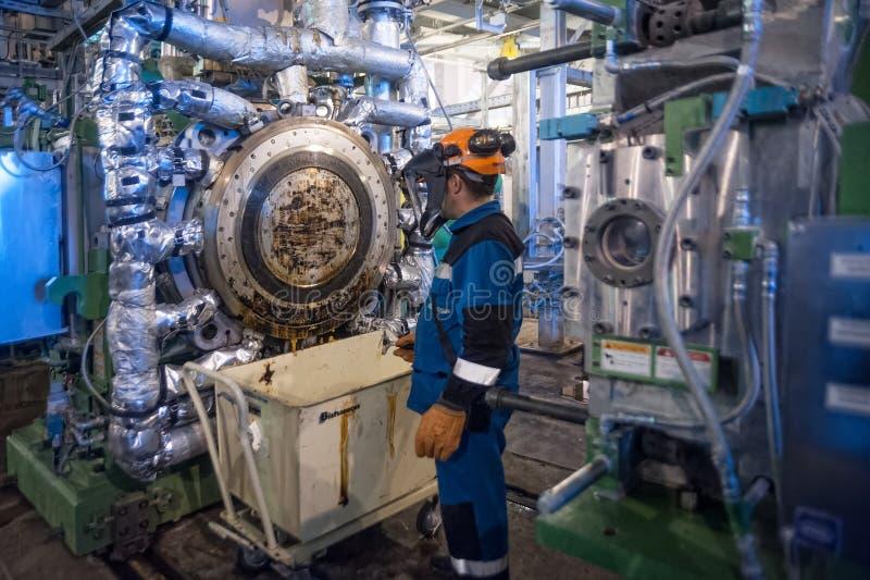 Industrial mechanic cleaning extruder machine. Tobolsk, Russia - July 15. 2016: Sibur company. Tobolsk Polymer plant. Industrial mechanic cleaning extruder royalty free stock photography