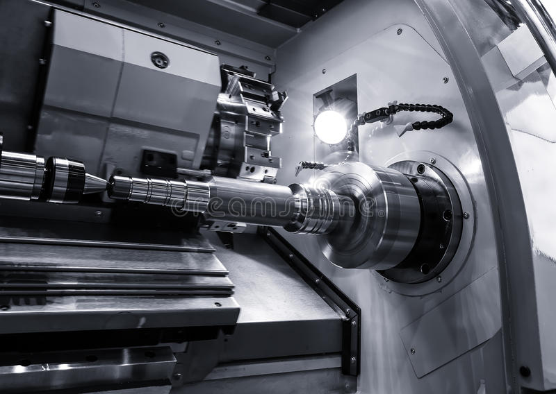 Industrial metal work bore machining process by cutting tool on automated lathe stock photography