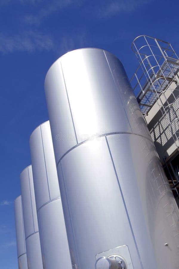 Industrial metallic tanks stock photo
