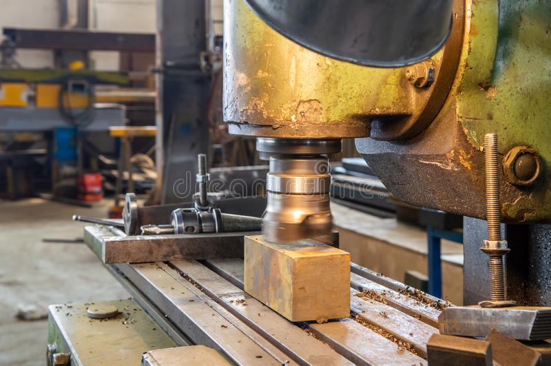 Industrial metalworking cutting process by milling cutter in a factory royalty free stock image