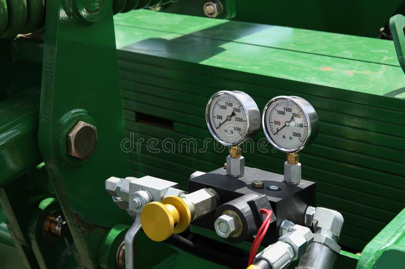 Industrial multi-stage centrifugal pump with two measures. Industrial multi-stage centrifugal pump with two gauges royalty free stock images