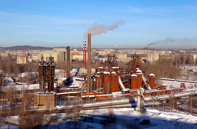 Industrial Nizhny Tagil. View from Bald Fox mountains. Nizhny Tagil, Russia - January 17, 2017: Metal, red domes. Before the construction of an old steam royalty free stock photography