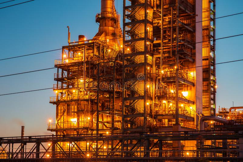 Industrial oil petrochemical refinery factory or plant with pipes and petroleum towers with night illumination stock photo