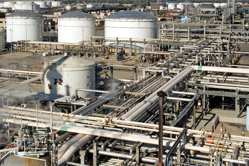 Industrial Oil Refinery. Oil refinery for making gasoline, diesel, and other fuels along with pollution and harm to the environment stock photography
