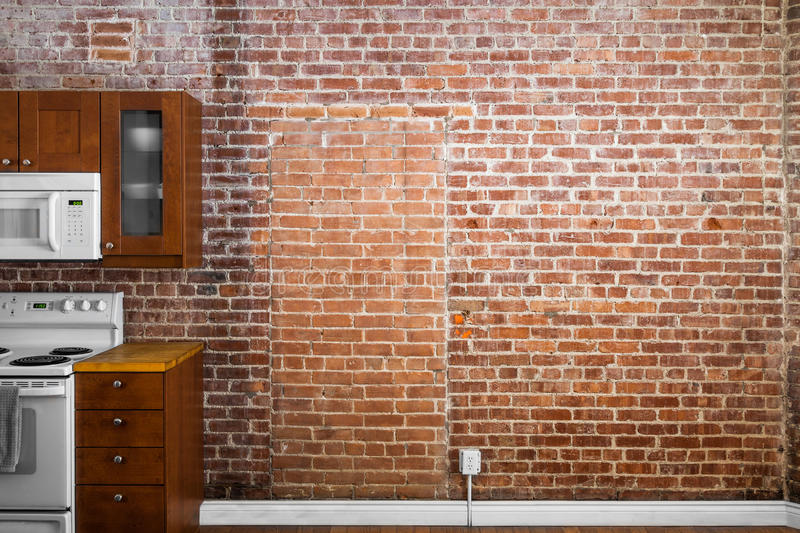 Industrial Old Flat Brick Wall Perspective in a kitchen. stock image