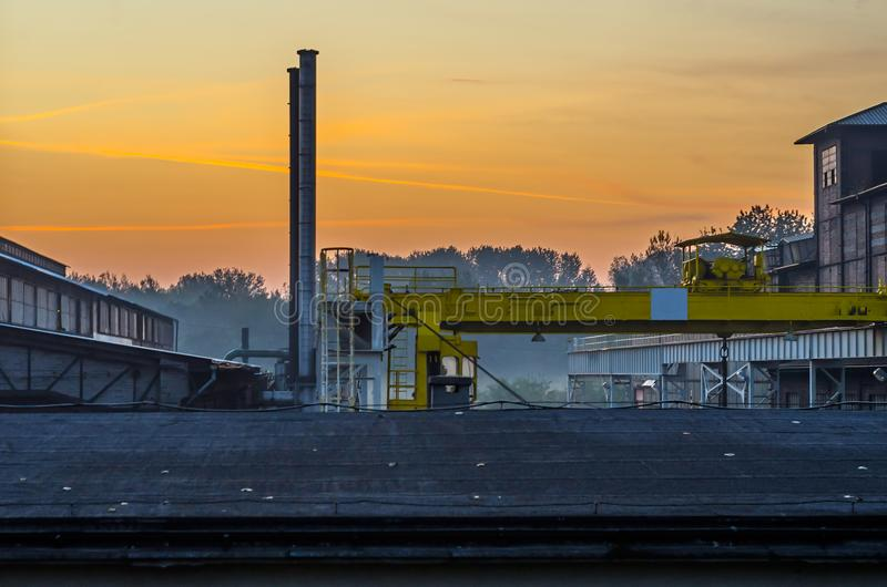 Industrial outdoor gantry and chimney in the ironworks outdoor scenery. stock photo