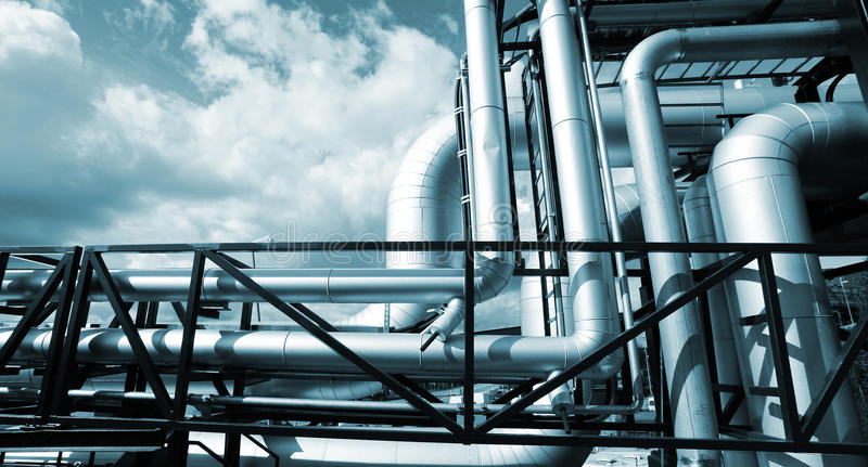 Industrial outside Steel pipelines in blue tones stock photo