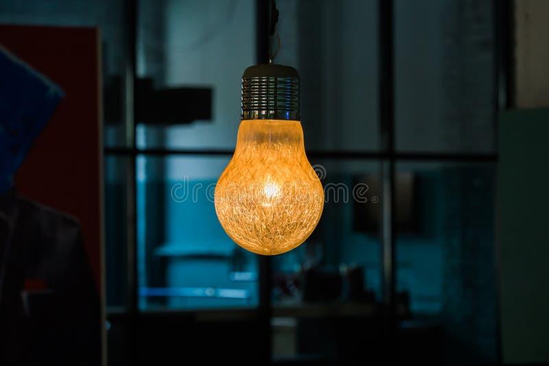 Vintage Incandescent Edison Type Bulb On Dark Background Light Bulb Of Unusual Shape Design