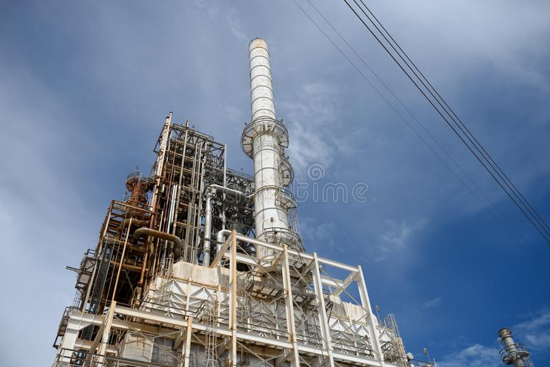 Industrial petrochemical oil and gas refinery smoke stacks, towers and pipes. Industrial petrochemical oil and gas refinery smoke stack, towers and pipes in stock photography
