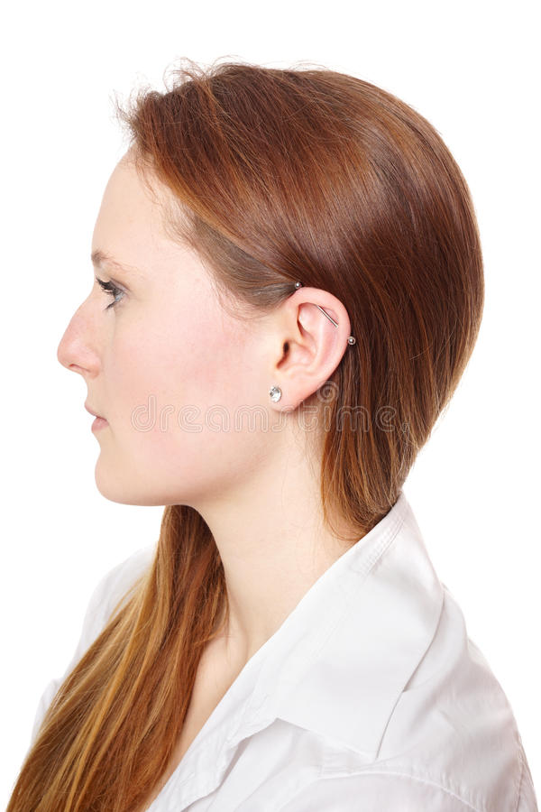 Industrial piercing. With barbell also known as scaffold or construction ear piercing stock photos