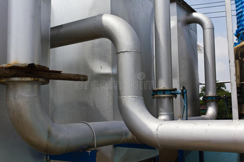 Industrial pipeline. In the rice husk power plant royalty free stock photography