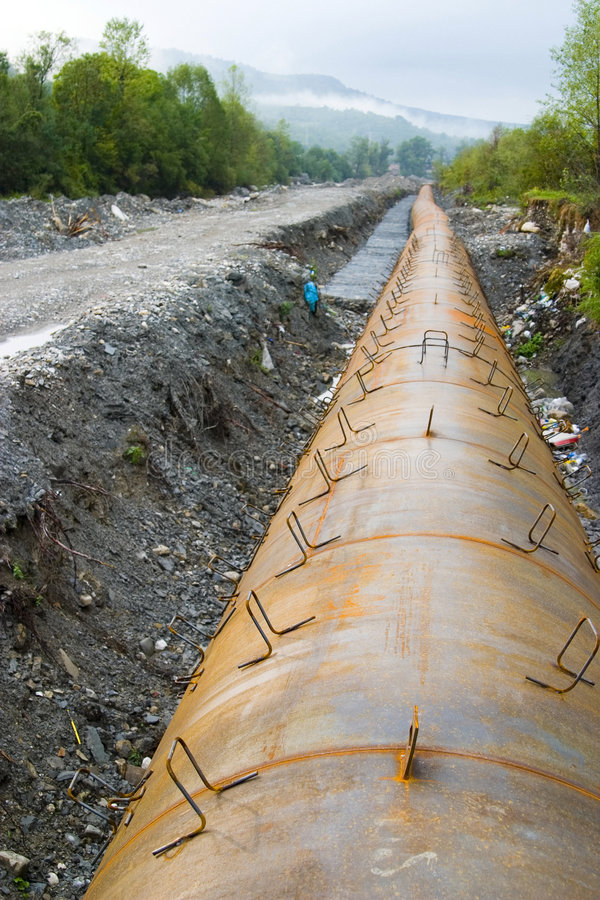 Industrial pipeline project. A view of construction work in progress to install a large, heavy duty industrial pipeline royalty free stock images