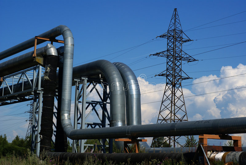 Industrial pipelines and electric power lines stock photo