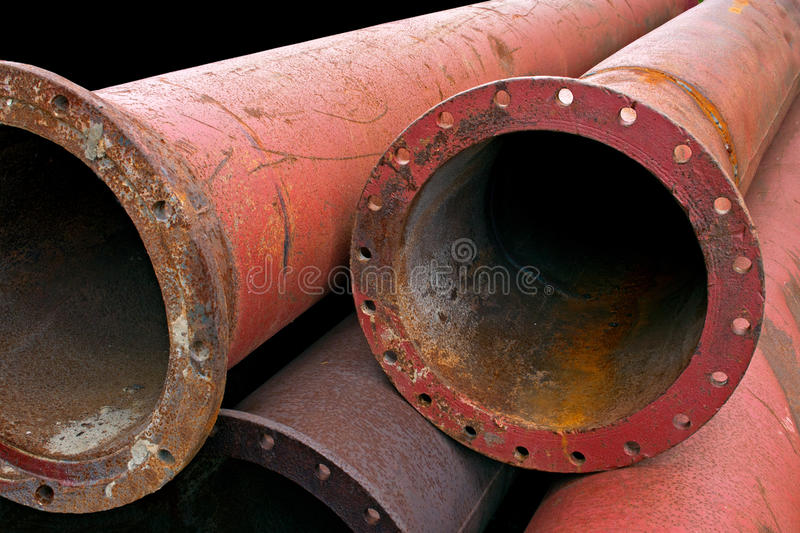 Industrial pipes. Aged rusty grunge industrial pipes close up royalty free stock images