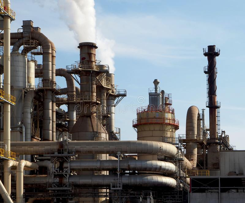 Industrial pipes and chimneys in a biomass, wood and paper factory stock image