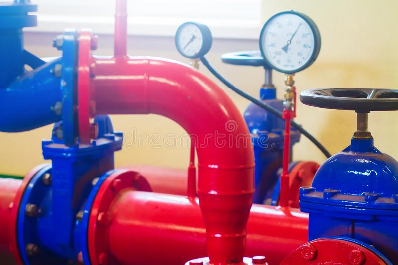 Industrial pipes and pressure sensors at factory stock image
