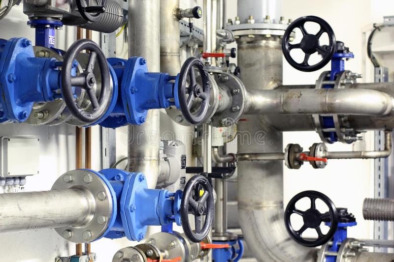 Industrial pipes and valves stock photos