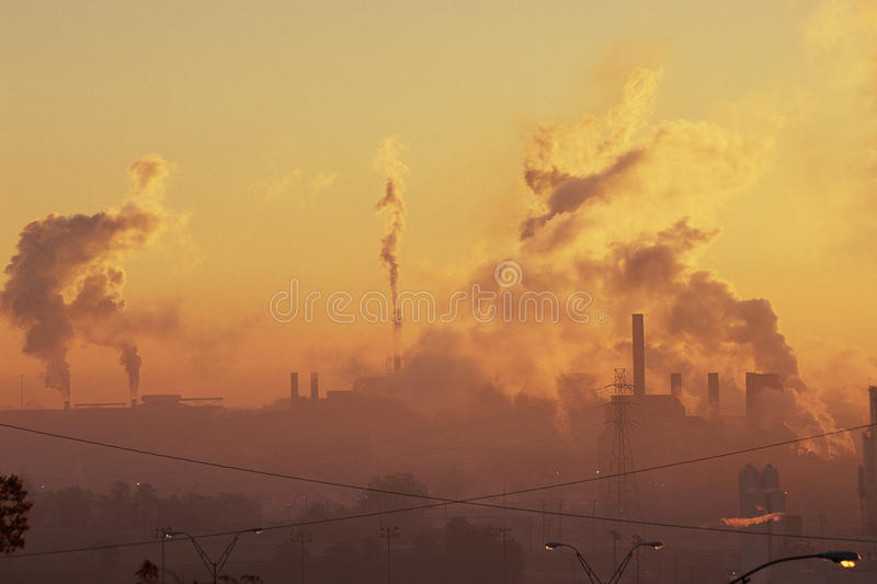 Industrial plant. Sunrise at industrial power plant stock photography