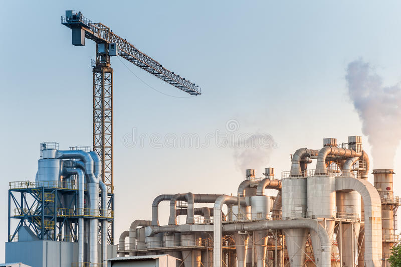 Industrial plant of a furniture factory. Chemical plant for the processing of chipboard of a furniture factory royalty free stock photography